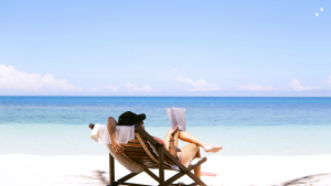 A woman reading a book on a beach